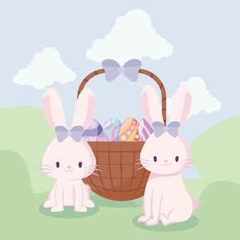 かわいいウサギの女性とイースターの卵のバスケット
