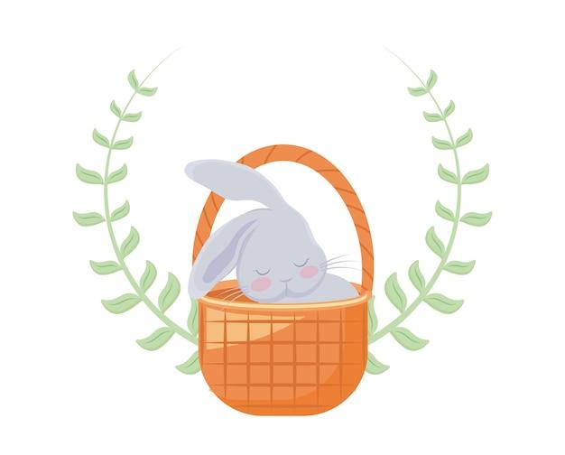 葉の冠とバスケットの枝編み細工品でかわいいウサギ