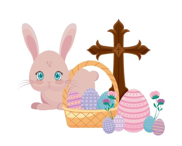 カトリッククロスとバスケットの枝編み細工品でイースターの卵かわいいウサギ