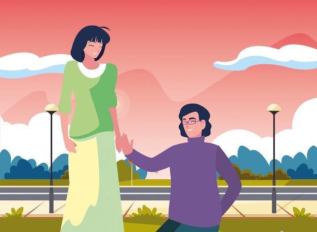 手を握って女性とひざまずく男