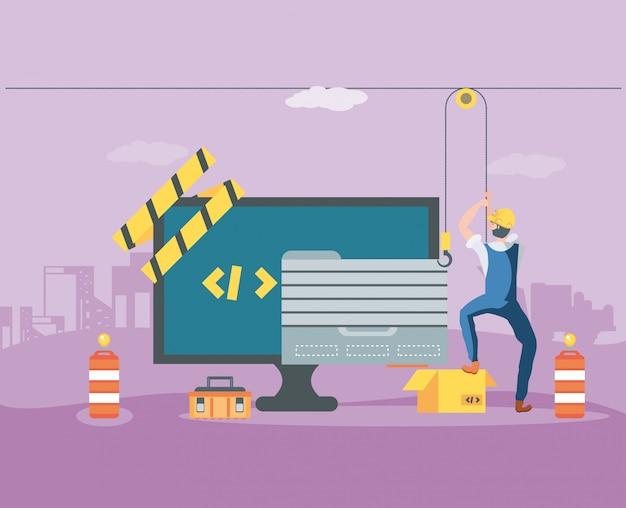 Строители и рабочий стол с веб-страницей в разработке