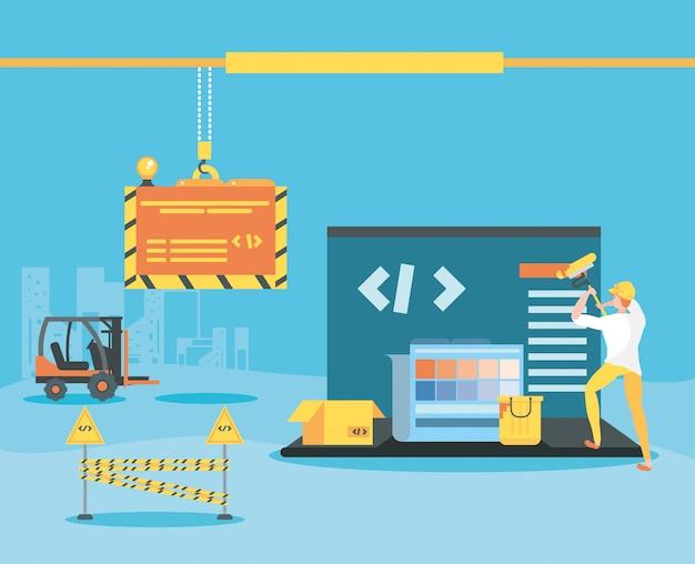 ビルダーとラップトップの建設中のウェブページ