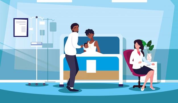 担架入院室で新生児を持つ親