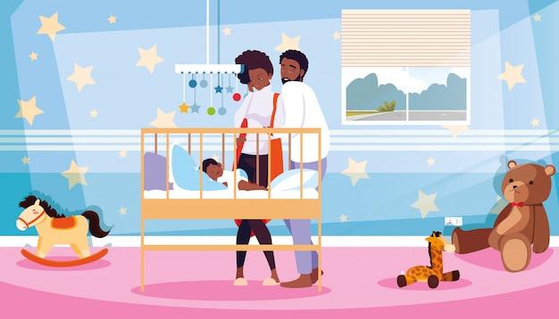 部屋で寝ている新生児を観察する親
