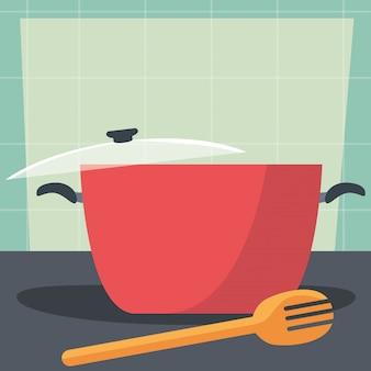 木製フォークとキッチンの鍋