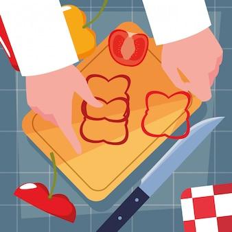 ナイフとキッチンボードとシェフの手