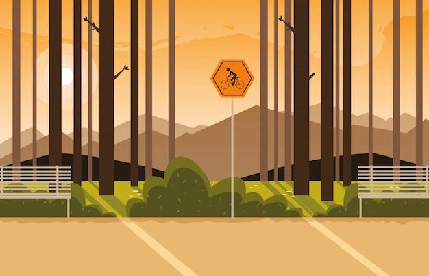サイクリストのための標識付きの森林景観シーン