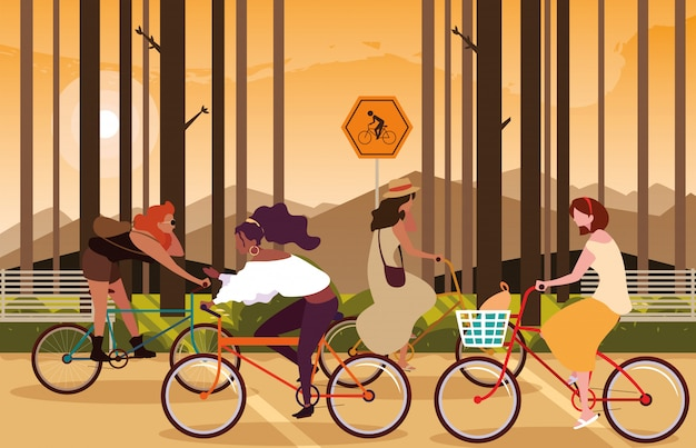 サイクリストのための看板と森林景観で自転車に乗る女性