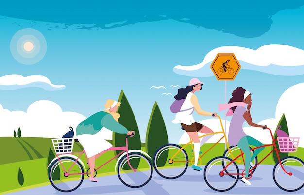 Женщины езда на велосипеде в пейзаж с вывесок для велосипедиста