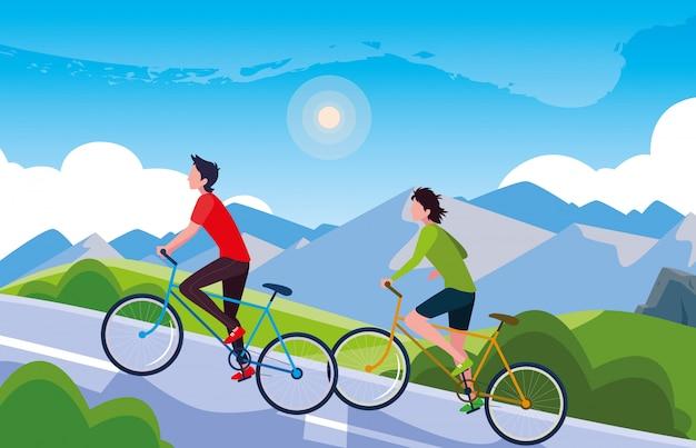 道路の山岳風景で自転車に乗る男性