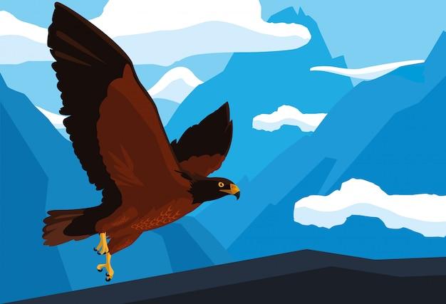 風景の中を飛ぶ鷹の鳥を課す
