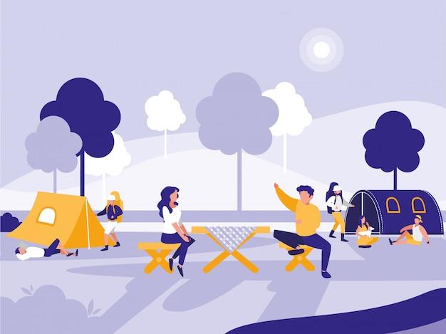 テントのある公園の人々