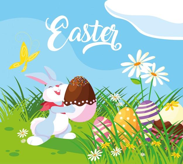 庭のイースターの卵とかわいいウサギ
