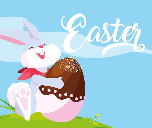 お菓子で飾られたイースターのウサギと卵