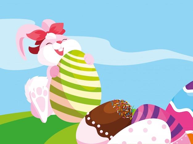お菓子で飾られた女性のウサギとイースターの卵