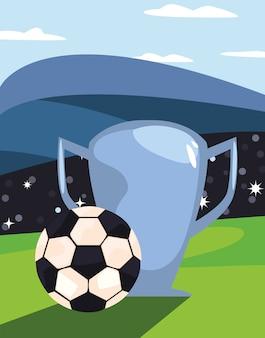 トロフィーを持つ古典的な黒と白のサッカーボール