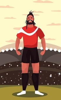 Футболист человек, стоящий на стадионе