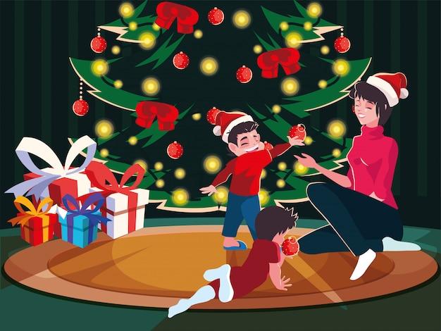 クリスマスツリー、クリスマスの夜のシーンを飾る子供を持つ女性
