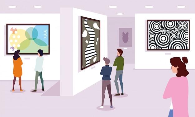 Группа людей в галерее современного искусства, посетители выставки осматривают современные абстрактные картины