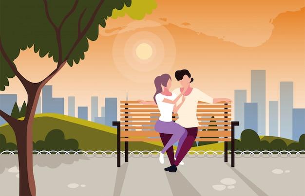 公園の椅子に座って愛の人々のカップル