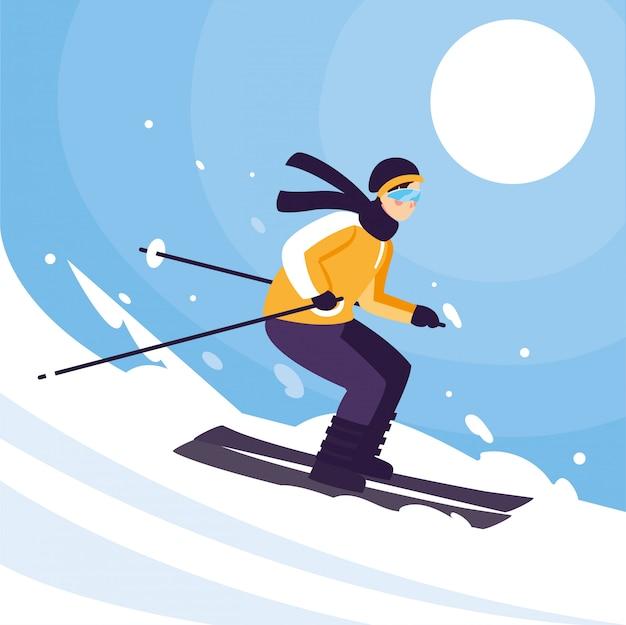 立っていると動きの山スキーを持つ男。アルペンスキー、極端な冬のスポーツ
