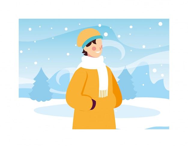降雪のある風景の中の冬服を持つ男