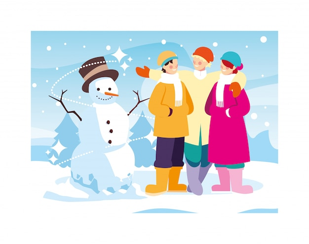 冬の風景に雪だるまを持つ人々のグループ