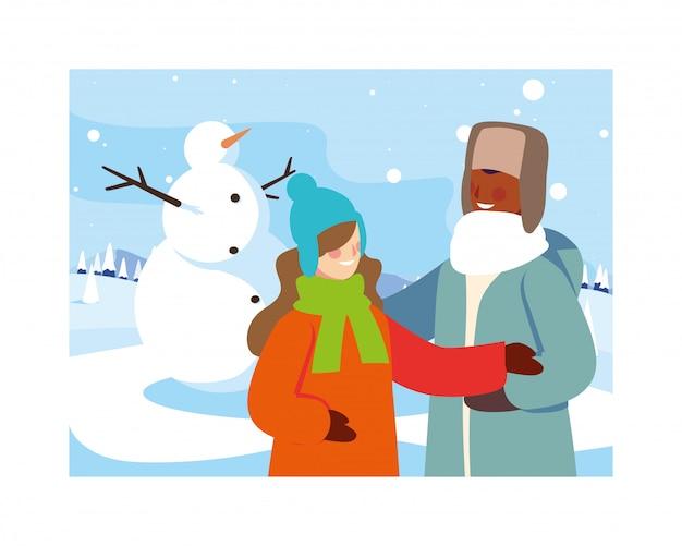 Пара людей со снеговиком в зимний пейзаж