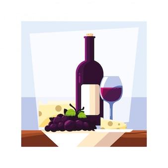 Бутылка и бокал вина с куском сыра и винограда