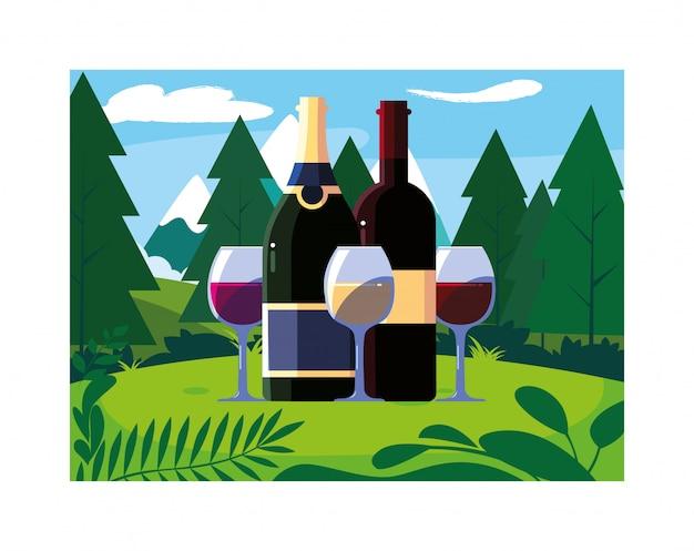 Бутылка и бокал вина с пейзажным фоном и природой