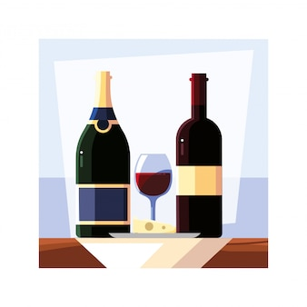 ボトルとチーズとワインのグラス