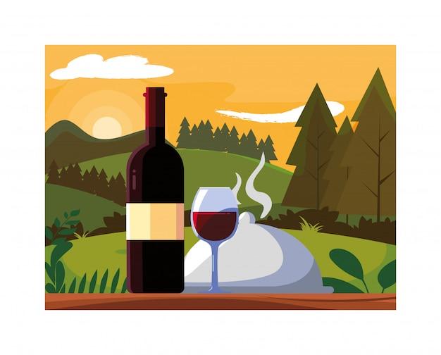 ボトルと背景の風景とワインのグラス
