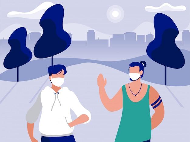 都市の建物の前の公園でマスクを持つ男性