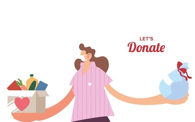 寄付するマスクと食べ物を持つ女性