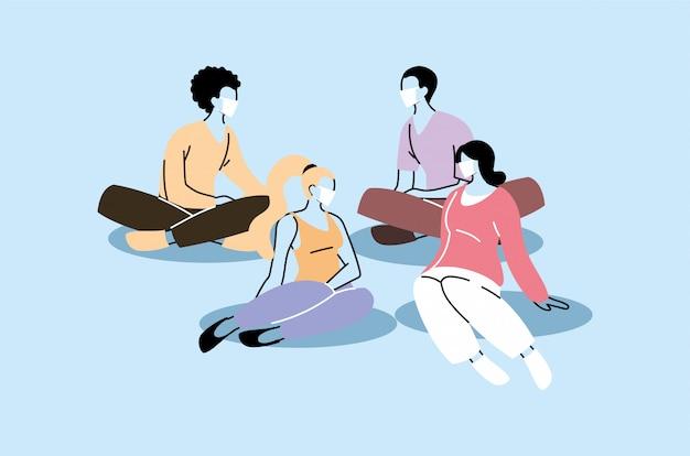 フェイスマスクで座っている人々のグループ