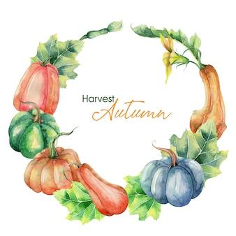 手描きのカボチャと水彩の秋の花輪