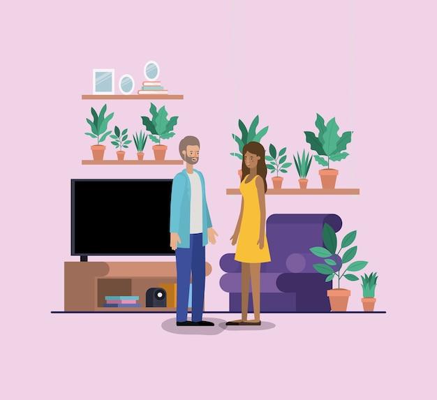リビングルームの若いカップル