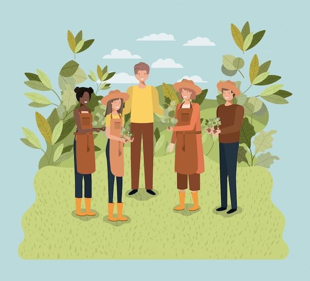 公園に木を植える人々のグループ