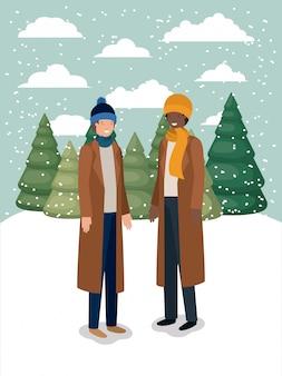 冬の服を着た雪景色の男性のカップル
