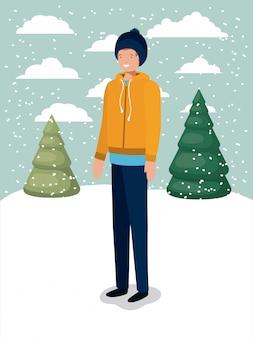 冬の服を着た雪景色の男