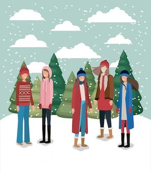 冬の服を着た雪景色の女性グループ