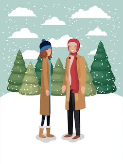 冬の服を着た雪景色の女性のカップル