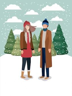 冬の服を着た雪景色のカップル