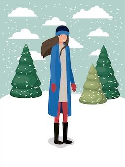 冬の服を着た雪景色の女性