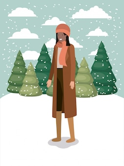 冬の服を着た雪景色の黒人女性