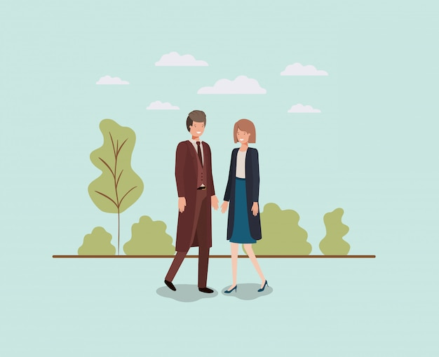 公園で歩くエレガントなビジネスカップル