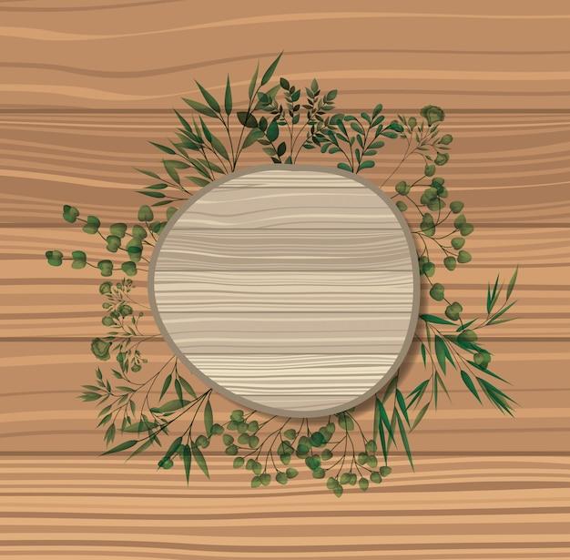 月桂樹と円形のフレームは、木製の背景を葉