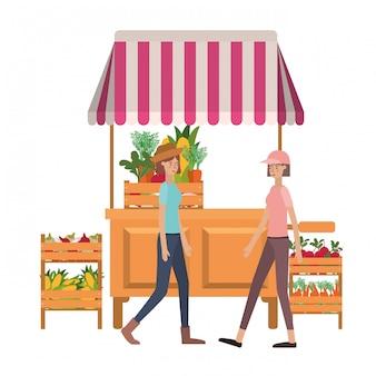 野菜のアバター文字と店のキオスクの女性