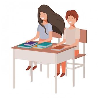 スクールデスクに座っている若い学生