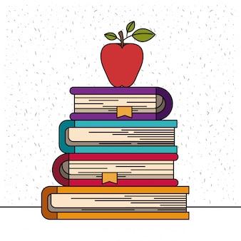 リンゴ果実と本のスタックの輝きと白い背景
